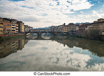 Reflections on the Arno river in Florence - A view of...