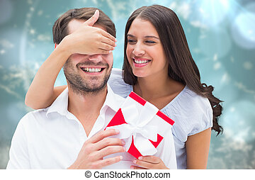 Composite image of woman surprising boyfriend with gift -...