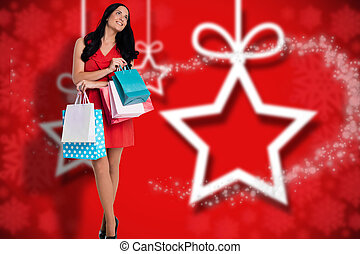 Composite image of woman standing with shopping bags - Woman...
