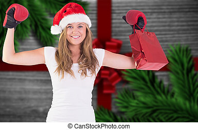 Composite image of festive blonde with boxing gloves and...