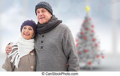 Composite image of mature winter couple - Mature winter...