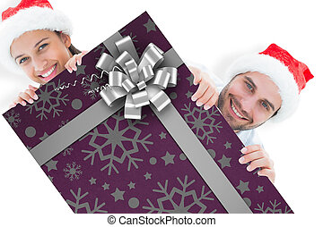 Composite image of festive young couple smiling at camera