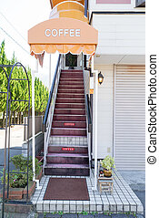 Stairway to the coffee shop on second floor with a colorful...