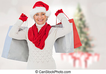 Composite image of festive woman holding shopping bags -...