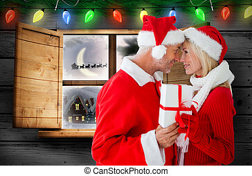 Composite image of festive couple - Festive couple against...