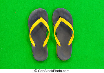 Rubber Slippers Placed on a green background - Black Rubber...