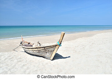 longtail boats - Traditional thai longtail boats sand beach...