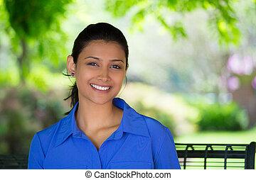 Woman relaxing outdoors - Closeup headshot portrait young...