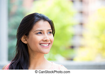 Daydreaming woman - Closeup headshot portrait, smiling,...