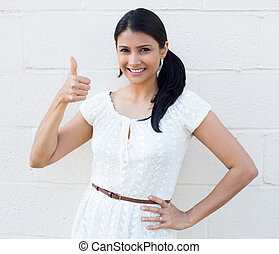 Thumbs up - Closeup portrait, young pretty smiling woman,...