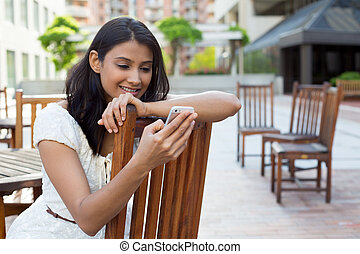 Browsing text messages - Closeup portrait, young happy...