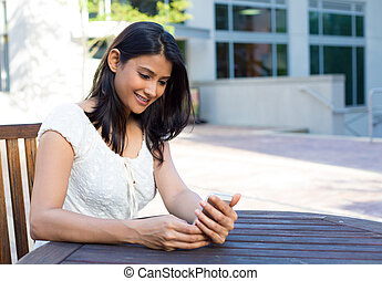 Perusing emails and texts - Closeup portrait, young happy...