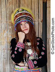 Traditionally dressed Mhong hill tribe woman thinking in the...