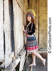 Traditionally dressed Mhong hill tribe woman in the wooden...