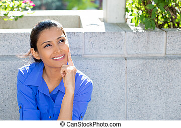 woman day dreaming - Closeup portrait, charming upbeat...