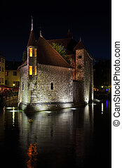 Castle reflected in the dark water - Summer night in the...