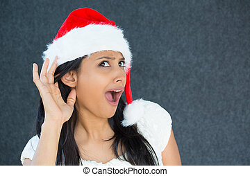 christmas woman eavesdropping - Closeup portrait of a cute...
