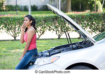Car problems - Closeup portrait, young woman in pink tanktop...