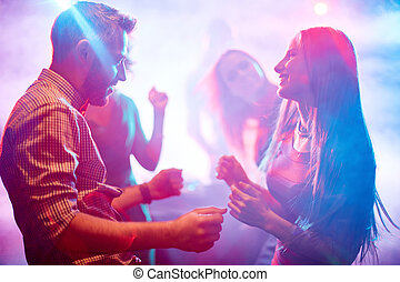 Dancing couple - Happy young couple dancing in night club