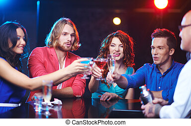 Group of friends toasting - Friendly people toasting at...