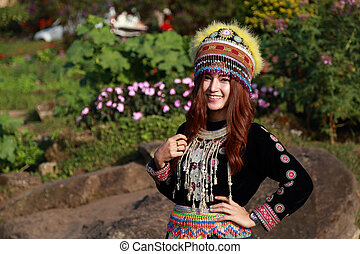 Traditionally dressed Mhong hill tribe woman in the garden...