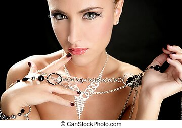 Ambition and greed in fashion woman with jewelry in hands on...