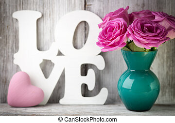 Valentine's, day. - Pink roses in a vase with a Valentine's...