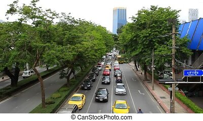 BANGKOK 2014 August 2. Traffic moves along a busy city centre road of the Thai capital.