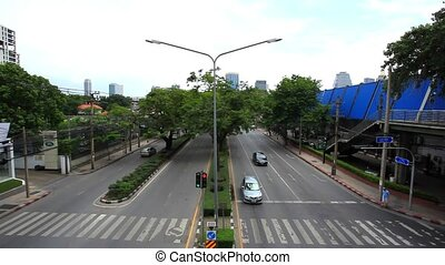 BANGKOK 2014 August 2. Traffic moves along a busy city centre road of the Thai capital. Timelapse speed up