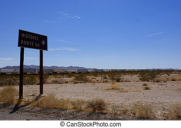 Route 66 Train - Route 66 sign in the desert with a train in...