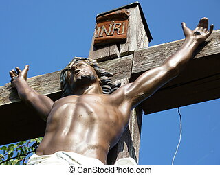 Jesus on a wood cross - Jesus up body on a wood cross with...