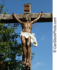 Jesus on the cross - Sculpture of suffering Jesus on a wood...