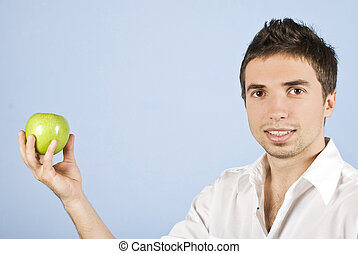 Young male holding an green apple - Young male holding an...