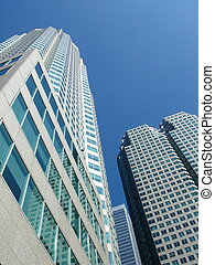 Buildings photographed from below with deep blue sky