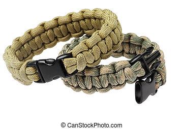Paracord Survival Bracelets On White Background