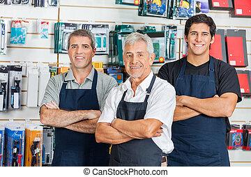 Confident Salesmen In Hardware Store - Portrait of happy...