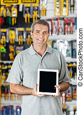 Man Displaying Digital Tablet In Hardware Store - Portrait...