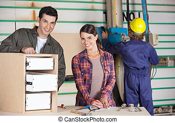 Confident Carpenters Making Cabinet - Portrait of confident...