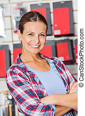 Confident Customer With Arms Crossed In Hardware Shop
