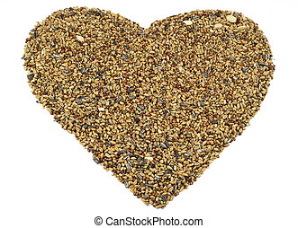 A heart made of bird seed