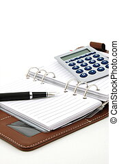 business organizer, notebook or planner with pen