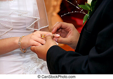 Wedding Ceremony - Groom Putting Wedding Ring on Bride`s...