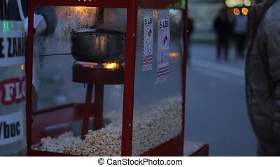 Buying PopCorn - Outdoor night party, someone buys a...