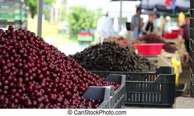Bunch of Cherries at Market - Large piles of cherries and...
