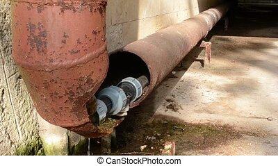 Broken Rusty Water Pipe - A rusty old water pipe let drop...