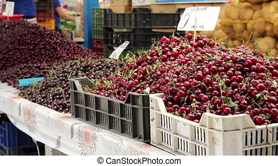Cherries for Sale at Market - Boxes with cherry put on sale...