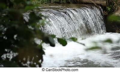 Cataract Falls - A small foamy waterfall on a mountain...