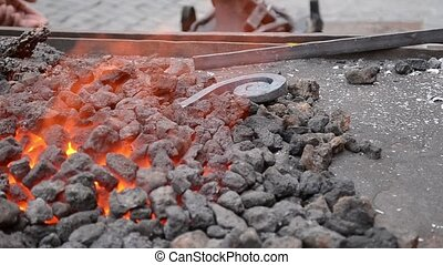 Coal in the Fire Forge - Burning coal in an electric forge A...