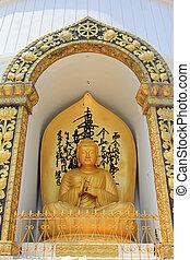 Buddha statue at World Peace Pagoda - Golden Buddha statue...