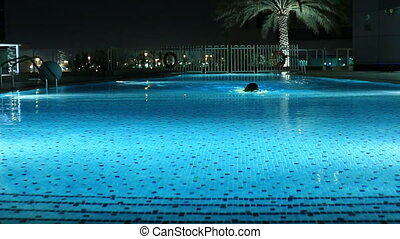 women swimming a luxury pool - attractive blonde women...